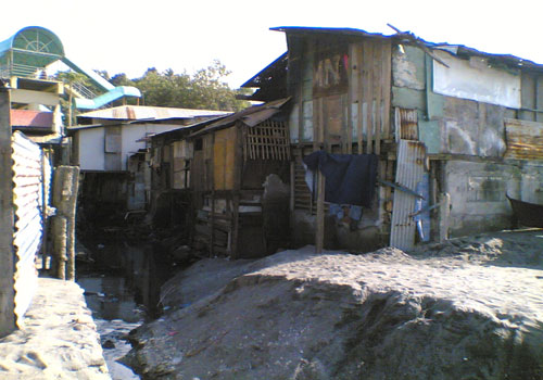 The Integrated Approaches to Poverty Reduction at the Neighborhood Level - A Cities Without Slums Initiative