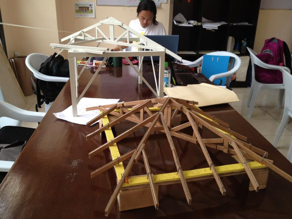 Study models of the wooden roof structure.