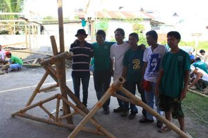 Carpenters from Roxas learn practical and affordable measures in building back better, safer shelter constructions. Photo by Ilija Gubic.
