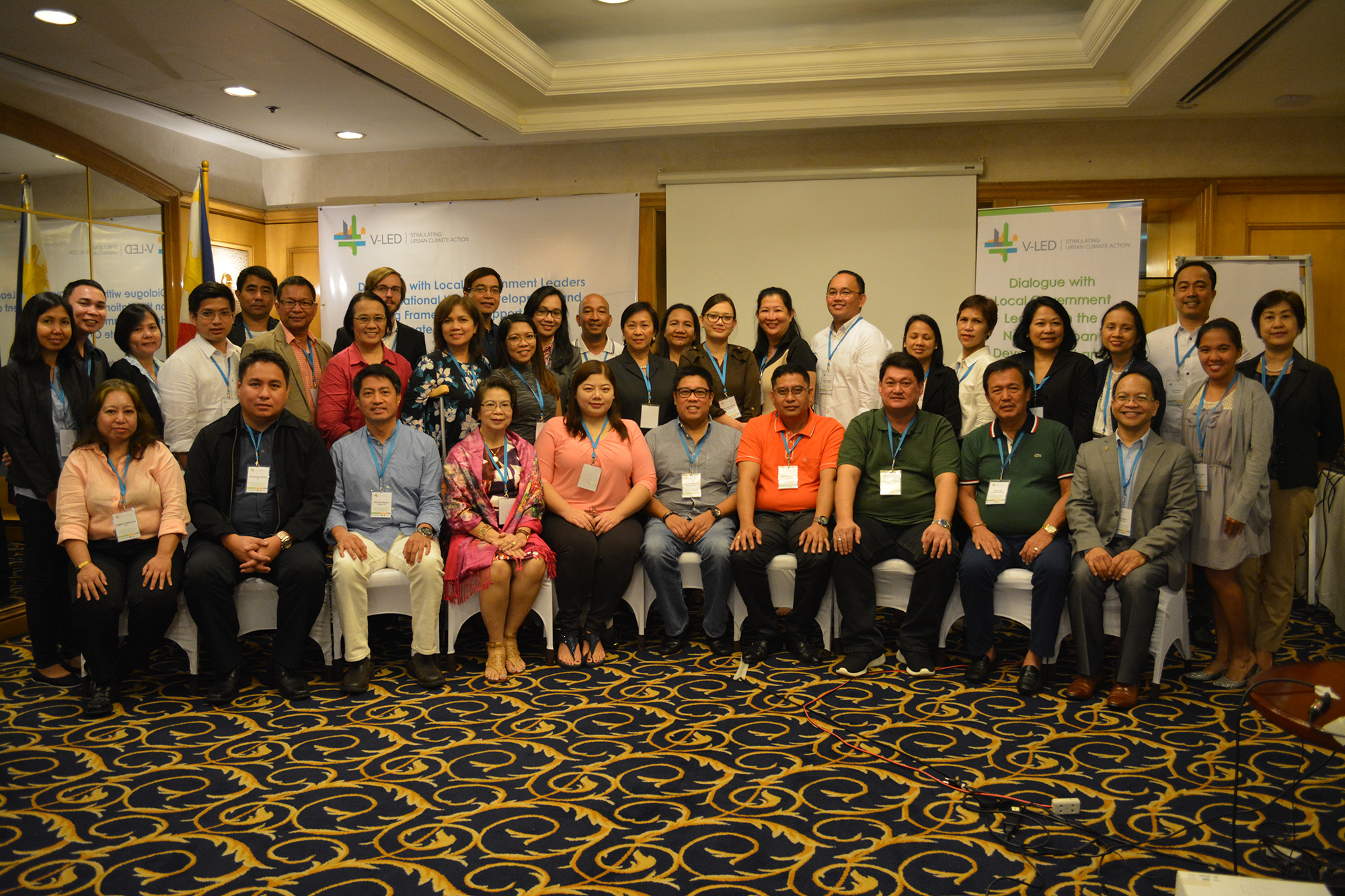 Participants of the dialogue event on the National Urban Development and Housing Framework (NUDHF) in Support of Local Climate Change Actions.